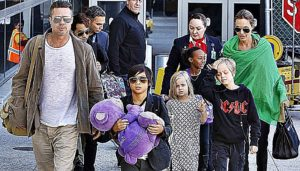 Hollywood actor Brad Pitt and Angelina Jolie along with their 5 children all arrived back into Los Angeles on a flight from Australia. The family had spent the past 4 month in Australia whilst Angelina was directing a movie downunder. Pictured: Brad Pitt, Angelina Jolie, Kids Ref: SPL693804 050214 Picture by: SPW/Splash News Splash News and Pictures Los Angeles: 310-821-2666 New York: 212-619-2666 London: 870-934-2666 photodesk@splashnews.com